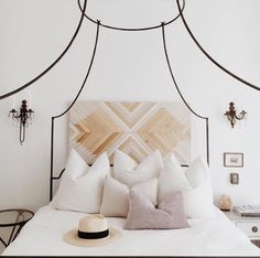 One of my favorite designs I have found on Pinterest- I am looking for this headboard/ wooden art piece constantly!