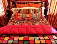 funky, cool bed - love the dia de los muertos pillow!