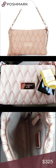 Valentino Rose Gold Quilted Cross Body Bag! NWT! Get your hands on this trendy quilted butter soft leather Valentino bag! The color is blush with delicate rose gold accents - the Pantone color of the year! This is bag is Valentino by Mario Valentino! The bag is perfect for your evening out or for every day use - dual straps can be adjusted for over your arm, on your shoulder or as a cross body. Don't miss out on my amazing deal - 50% off retail price ($785)! Authentic bag with card! Measures…