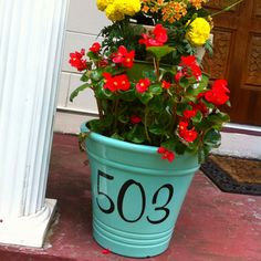 My newest DIY. My house number on flower pot on porch