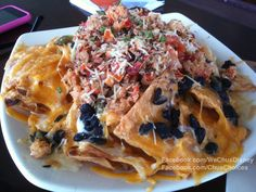 DCA - Cove Bar. Lobster Nachos. Tender Lobster pieces atop fresh corn tortillas chips smothered in black beans, tomatoes, roasted poblano peepers, cilantro and jack & chedder cheeses.