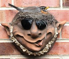 Troll Planter with Shades brings a boring wall to life with cool personality! Wall pocket planter with one-of-kind expression in warm terra-cotta is ideal for succulents, miniature plants, flowers or