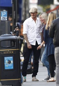 Cappy to see you: Meanwhile, husband David was instantly spotted by a female fan as he walked through the neighbourhood