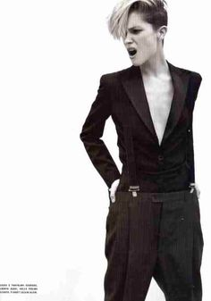 fitted suit jacket tucked into loose trousers w/ suspenders - great twist!