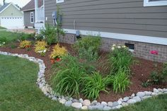 bed landscape edging | Mix and match stone shapes and colors for a natural edge.