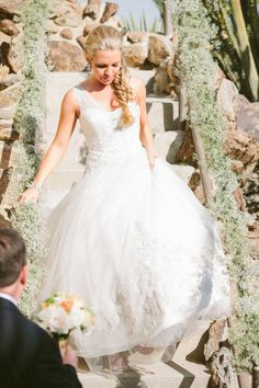 One shoulder wedding gown by Oleg Cassini | See the wedding on SMP: http://www.stylemepretty.com/2013/10/25/palm-springs-wedding-from-laura-goldenberger-photography/ Photography: Laura Goldenberger