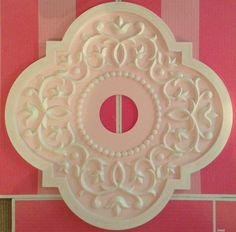 Ceiling Medallions by Marie Ricci. Shown in distressed pale pink, www.mariericci.com