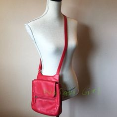 "REDUCED % Genuine Red Leather Bag Can be adjusted to shoulder or cross body. Leather - no scratches in the leather or gauges, very soft. Faint light line across the front as pictured. Multiple compartment for versatility.  Front compartment measures approximately 8"" across and less than 8"" deep. Back compartment opens to reveal side pockets and card pockets worn close to the body. No Trades Jack Georges Bags"