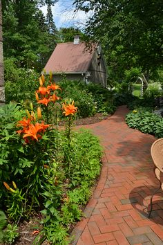 Red brick pathways are one of the highlights of the yard of John Taylor and Mary  Brennan-Taylor of 480 Pine St., Lockport. You can see their yard during Lockport in Bloom, a citywide garden tour to be held from 10 am to 4 pm Saturday & Sunday, July 13 & 14, 2013. The event will also feature Twilight in the Garden from 6:30 to 9 pm Saturday only and a vendor fair 10 am to 5 pm Saturday & Sunday. Maps will be available the day of the event at the Kenan Center, 433 Locust Street, Lockport.