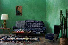 emerald green walls - green Venetian plaster walls in a concept living room with a cobalt sofa - Anthropologie.eu via Atticmag