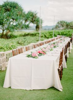 Extra wide banquet tables with Ivory linen and fruitwood chivari chairs.
