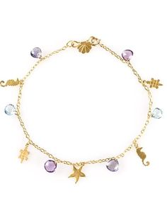 22 carat gold Hawaii charm bracelet from Marie Helene De Taillac featuring a spring-ring fastening, a cable chain, faceted stones and silhouette charms.