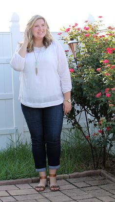 White peasant blouse, cropped jeans, embellished sandals and a Kendra Scott tassel necklace