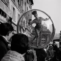 Melvin Sokolsky: Bubble series. The Bubble series was shot by fashion photographer Melvin Sokolsky for the Harper's Bazaar 1963 Spring Collection. Inspired by The Garden of Earthly Delights, this surreal series of photographs depicts model, Simone D'Aillencourt, in large bubbles floating through the Paris cityscape. Since we are talking pre-Photoshop, the plexiglass bubbles had to be hung from a crane in various locations throughout the city. Via: http://www.iainclaridge.co.uk