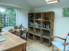 New shed project 16 - At last I'm in! My new shed project started on April 4th and this afternoon the interior was finished and I moved my furniture in. An old teachers' desk, twelve apple crates from Kent for shelving, a 1960s tea trolley and an old armchair given to me by a friend. As I type this the blackbirds are singing. What a happy day !