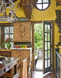 A kitchen cupboard is made from copies of old French doors.