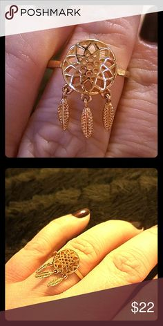 Dream catcher ring Gold colored dream catcher ring with dangling feathers is a great accessory that will get lots of compliments! Size 8 Jewelry Rings