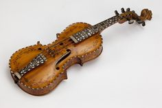 "1872 Norwegian Hardanger fiddle at the Victoria and Albert Museum, London - From the curators' comments: ""The Hardanger fiddle is a Norwegian variant of the violin, dating from about 1650. It is strung with eight strings, four of which vibrate while a bow plays the others....Hardanger fiddles are used for folk singing, dances and wedding processions. Edvard Grieg (1842-1907), Norway's greatest composer, incorporated the traditional melodies played on such fiddles into his compositions."""