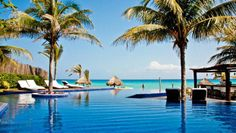 Le Reve Hotel & Spa: The Caribbean Sea unfolds beyond the propertys infinity pool and Xcalacoco beach.