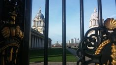 Canary Wharf seen through the gate of Greenwich University