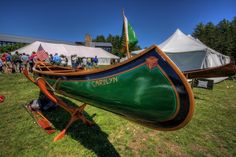 An Old Town Wooden canoe showing the wooden ribs and painted canvas with its lovely oak and brass stem. Paul Smiths in the Adirondacks.