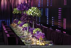 Mirrored kings table featuring arrangements of purple vanda orchids, green and purple cymbidium orchids, purple sweetpea, viburnum and double white freesia.