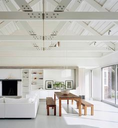 Elegant All White Homes  New York architect Robert Young designed this lakefront home to accommodate a growing family and all their friends. The finished house is the ultimate in airiness, with an open floorplan, high cathedral ceilings and exposed beams, all accentuated in crisp white.