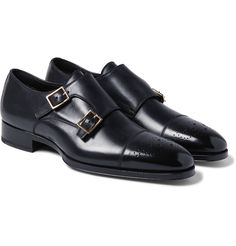 <a href='http://www.mrporter.com/mens/Designers/Tom_Ford'>TOM FORD</a>'s 'Austin' monk strap shoes are perfect for shaking up your selection of black footwear. They are crafted from immaculate polished-leather and detailed with brogue-style perforations.