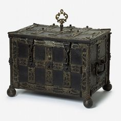 The rectangular hinged lid with elaborate strapwork locking mechanism to underside, opening to a vacant interior, the case with engraved onlaid straps and twin handles to sides, raised on ball feet. Antique Safe, Antique Boxes, Old Trunks, Trunks And Chests, Vault Doors, Medieval Furniture, Wooden Chest, Pretty Box, Casket