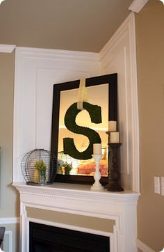"fireplace decor - hang a mirror with monogram ""G""  hmmmm...."
