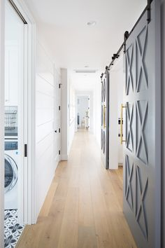 Hallway Main Hallway ideas The staircase leads to a long hallway with shiplap and wide plank hadwood floors Hallway Main Hallway Hallway Main Hallway Hallway Main Hallway #Hallway #MainHallway #shiplap #wideplank #hardwoodfloors #barndoors