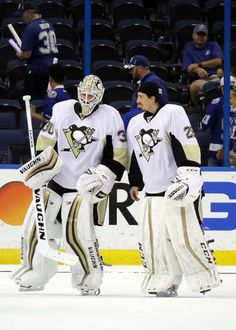 PITTSBURGH PENGUINS VS. TAMPA BAY LIGHTNING - GAME THREE TAMPA, FL - MAY 18: Matt Murray #30 of the Pittsburgh Penguins celebrates with his teammates Marc-Andre Fleury #29 after defeating the Tampa Bay Lightning in Game Three of the Eastern Conference Final with a score of 4 to 2 during the 2016 NHL Stanley Cup Playoffs at Amalie Arena on May 18, 2016 in Tampa, Florida. (Photo by Bruce Bennett/Getty Images)