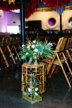 Rattan Side Table with Floral Bouquet | Bohemian Ceremony Seating Accessories | via Birch & Brass Vintage Rentals for Weddings and Special Events in Austin, TX