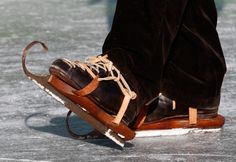 A referee wears traditional wooden skates during the Frisian Shorttrack Championships in Techendorf, Austria