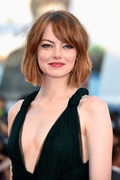 Emma Stone looks sophisticated with side-swept bangs and a chic bob. // #hair