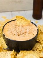 A cheese dip with a from scratch taco seasoning straight out of the Schweid and Son's Cookbook. Great for parties or to devour on game night!