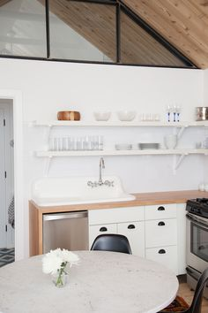 Casual Bohemian Bungalow | white & wood kitchen