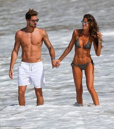 Hand-in-hand: Izabel and soccer player boyfriend Kevin Trapp went for a romantic walk in the Caribbean waters