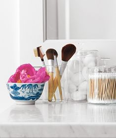Put everyday essentials, including cotton balls and swabs in clear containers. So you can see when supplies are dwindling and know when it's time to stock up. Consider using any repurposed vessels or glass apothecary jars. Organisation Hacks, Bathroom Organisation, Home Organization, Organizing Clutter, Organized Bathroom, Organising, Ikea Hacks, Glass Apothecary Jars, Ideas