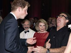 "Robin Williams howling with laughter when he meets Prince Harry at the comedy show ""We Are Most Amused"", November 2008."