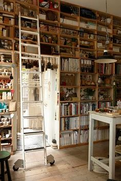 I would LOVE to have a studio for my writing and painting with this kind of library surrounding my work area.