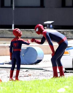 Andrew Garfield on set with a mini Spider-Man.