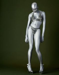 Metallic body painting; the model is Naomi Campbell