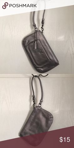 Silver metallic wristlet Silver leather Wristlet with small outer pocket and embossed eagle logo. Complete with leather fringe hangtag. NWOT American Eagle Outfitters Bags Clutches & Wristlets