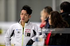 Daisuke Takahashi of Japan talks to his coach Utako Nagamitsu during practice at Budweiser Gardens in preparation for the 2013 World Figure Skating Championships in London, Ontario, Canada, March 11, 2013. Skaters from around the globe are preparing for the competition which starts on Wednesday. AFP PHOTO/Geoff Robins (Photo credit should read GEOFF ROBINS/AFP/Getty Images)