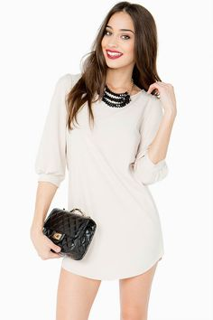 Classic and clean shift dress that can be dressed up or down. Solid chiffon body. U hem.