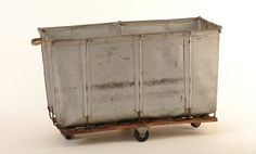 his would be a cool laundry room item. very restoration hardware looking. could be made with a up-cycled wooden palette with casters, Wichtita Large grey canvas laundry bin from found rentals