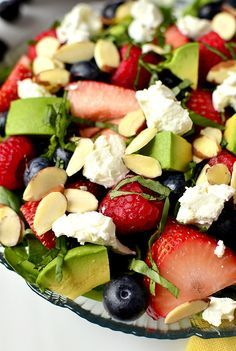 Triple-Berry Summer Salad 9oz baby spinach, torn 1 cup sliced strawberries 1 cup raspberries 1 cup blueberries 1/2 cup sliced almonds, toasted 1/3 cup chopped basil 1 avocado, chopped 4oz goat cheese strawberry vinaigrette