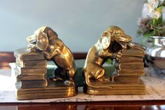 Please take time to look at all the photos. The ZOOM feature is amazing!    Great pair of vintage brass dogs bookends.    Dachshund dogs chewing on