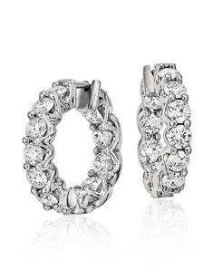 These diamond hoop earrings showcase 3.5 carats of Blue Nile Signature Ideal cut diamonds set in enduring Platinum, a versatile gift for any occasion.